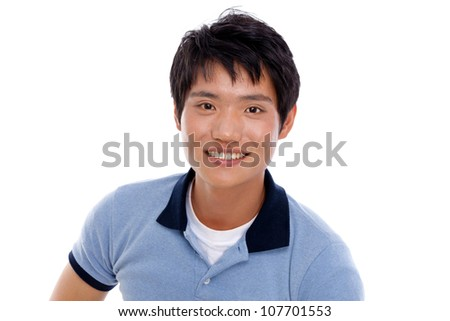 Happy smiling young Asian man show thumb isolated on white background. - stock photo
