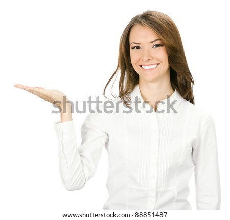 Happy smiling young beautiful business woman showing blank area for sign or copyspase, isolated over white background - stock photo