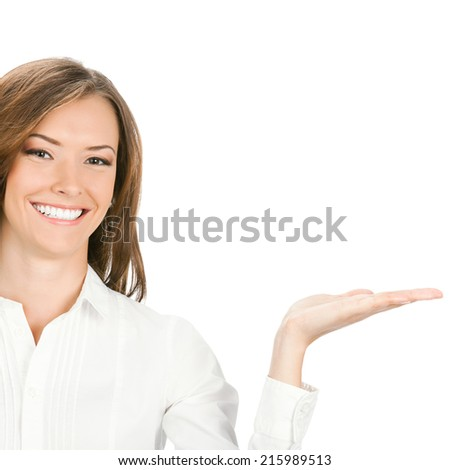 Happy smiling young beautiful businesswoman showing blank area for sign or copyspase, isolated on white background - stock photo