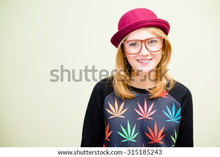 Happy smiling young blonde girl in funny outfit - stock photo