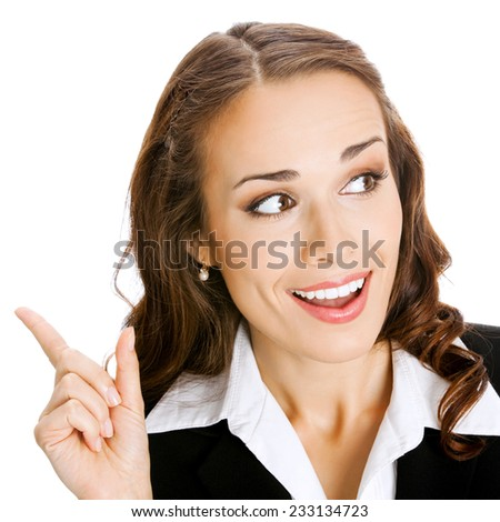 Happy smiling young business woman showing blank area for sign or copyspase, isolated against white background - stock photo