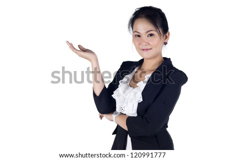 Happy smiling young business woman showing blank area for sign or copyspase, isolated on white background, Model is Asian woman - stock photo