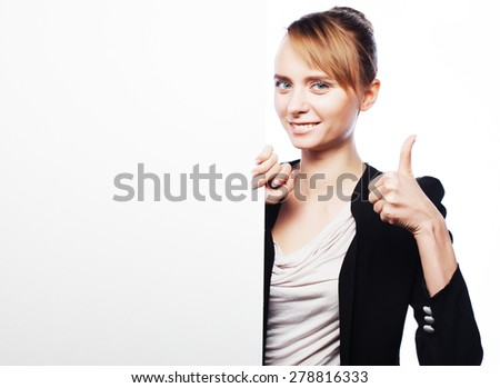 Happy smiling young business woman showing blank signboard, over white  background - stock photo