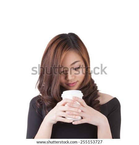 Happy smiling young businesswoman with coffee from disposable cup. Beautiful mixed asian / caucasian model. Isolated white background. - stock photo