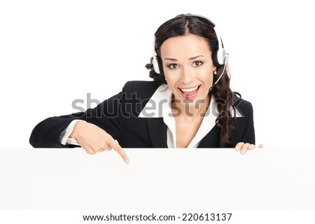 Happy smiling young customer support phone operator in headset showing blank signboard, isolated over white background - stock photo