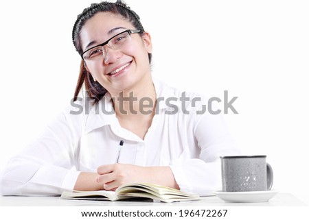 Happy smiling young lady in the office. Isolated in white background. - stock photo