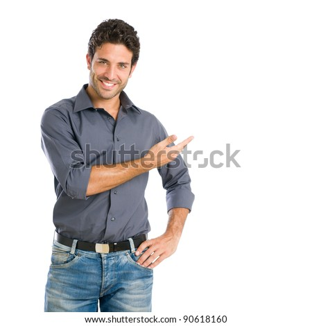 Happy smiling young man presenting and showing your text or product isolated on white background - stock photo