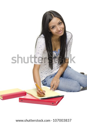 Happy smiling young student doing homework.  Image isolated against white background - stock photo