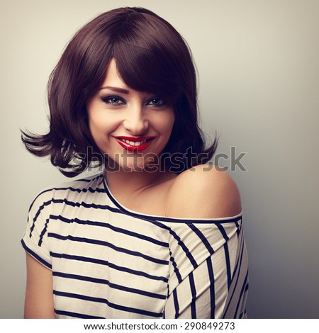 Happy smiling young woman with short black hair style. Closeup vintage portrait - stock photo