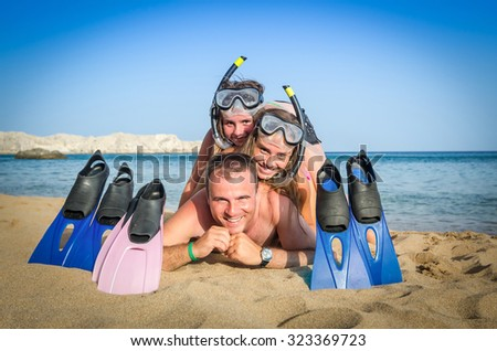Happy snorkeling family - stock photo