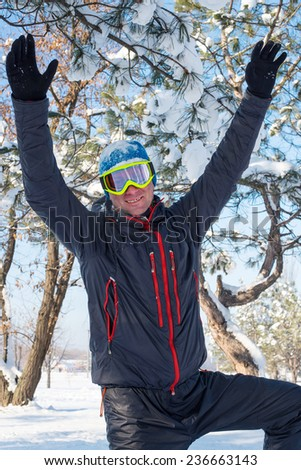 Happy snowboarder in winter forest - stock photo