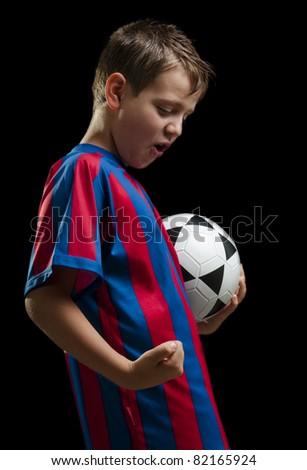 happy soccer kid on black - stock photo