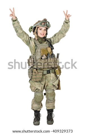 Happy soldier woman hands up and showing two fingers or victory gesture.image on a white studio background. lifestyle concept - stock photo