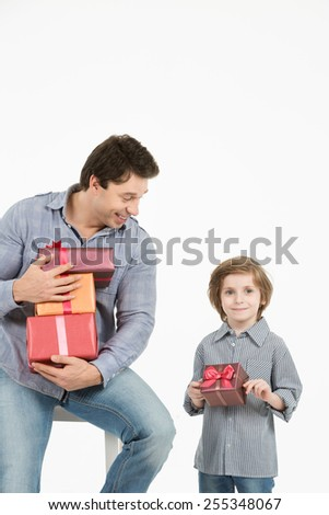 Happy son hugging his father and gives him gift. Fathers day, family holiday, vacation. Isolated white background. - stock photo