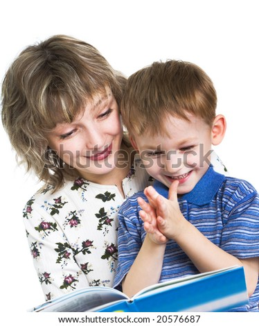 Happy son with mother read the book - stock photo