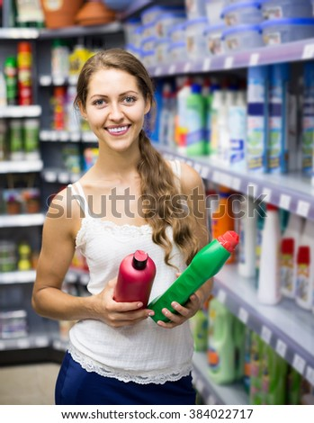 happy spanish people buying detergents for house in the shopping mall  - stock photo