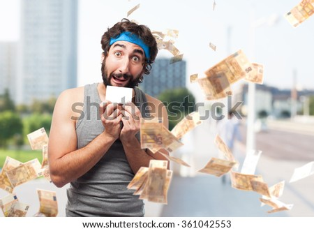 happy sport man with visit card - stock photo