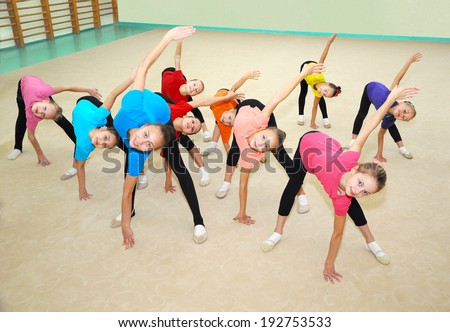Happy sporty children in gym - stock photo