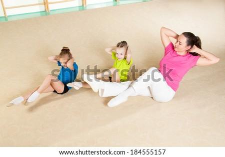 Happy sporty family in gym - stock photo