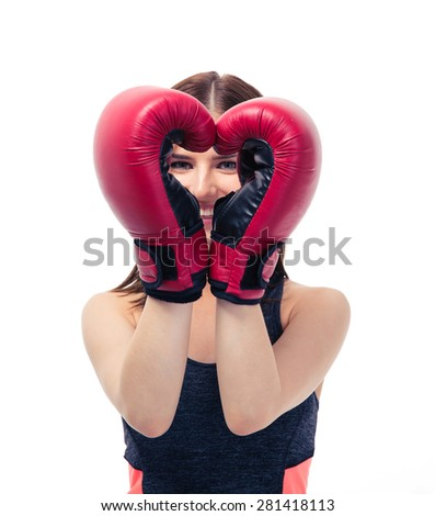 Happy sporty woman in boxing gloves making heart shape isolated on a white background - stock photo