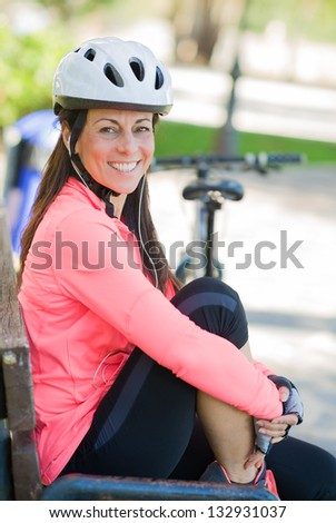 Happy Sporty Woman Listening To Music, Outdoors - stock photo