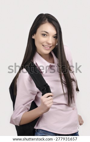 Happy student back to school. Beautiful student girl smiling holding a backpack. - stock photo