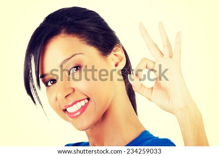 Happy student girl gesturing perfect, isolated on white - stock photo