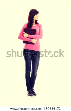 Happy student girl looking upper left corner - stock photo