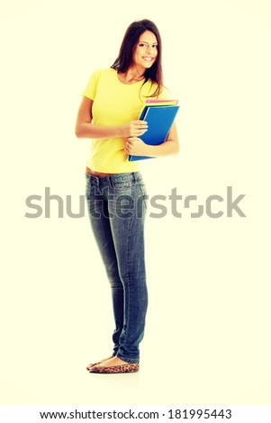 Happy student girl smiling - stock photo
