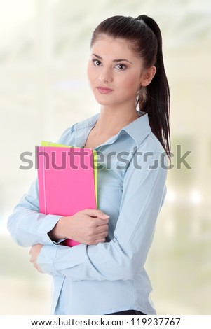 Happy student girl with notebooks - stock photo