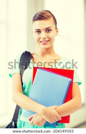 happy student girl with school bag and notebooks - stock photo