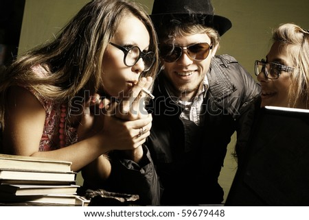 Happy  student group of friends smoke a cigaret - stock photo