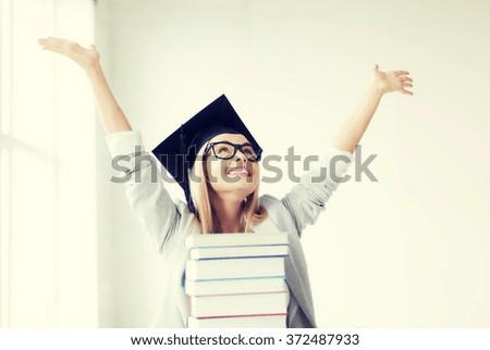 happy student in graduation cap - stock photo