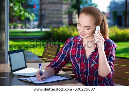 happy student or school girl talking on mobile phone in summer park - stock photo