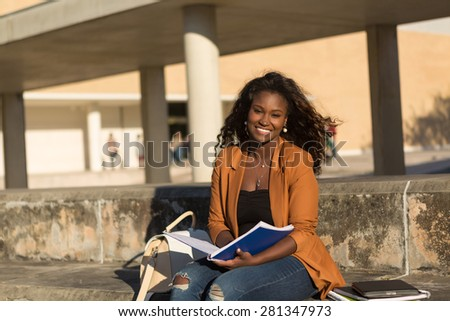 Happy student relaxing at the university campus - stock photo