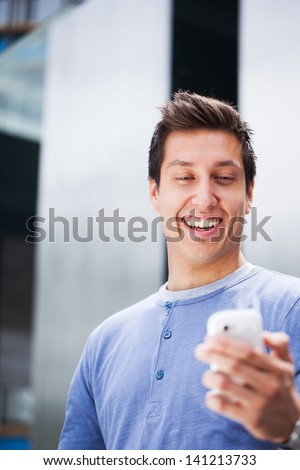 Happy Student Sending Text Message Using Mobile Smart Phone. - stock photo