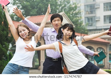 Happy students full of success. Group of excited young people opened hands with delight. Teenagers feel freedom after college graduation - stock photo