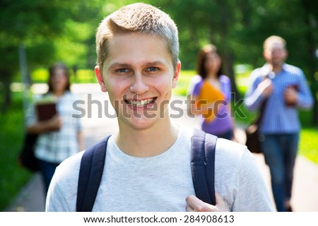 Happy students outdoors with his friends - stock photo