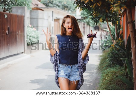 Happy stylish hipster girl,Colorful summer portrait of an attractive young woman with sunglasses,Outdoor fashion closeup portrait of young pretty woman in summer sunny day on grass  - stock photo
