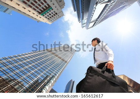 happy successful business man outdoors Next to Office Buildings with cityscape and sky, hong kong, asia, asian - stock photo