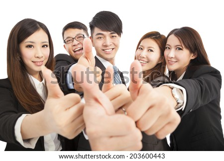 happy successful business team with thumbs up - stock photo