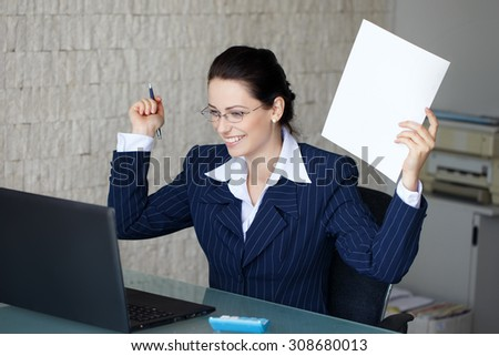 Happy successful businesswoman holding white paper at glass desk in office, teeth smile - stock photo