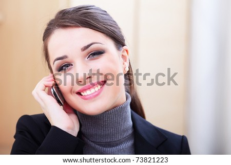 Happy successful businesswoman with cell phone - stock photo