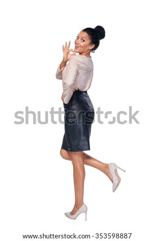 Happy successful mixed race caucasian - african american business woman in full lengh gesturing OK sign and smiling at camera - stock photo