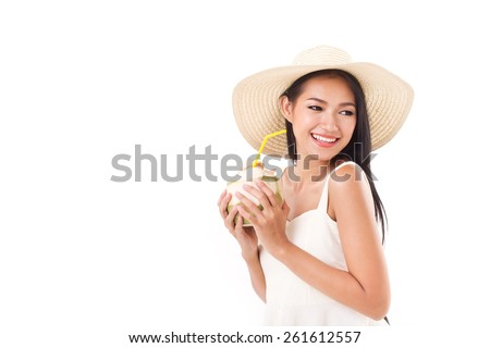 happy summer woman enjoying fresh coconut juice, looking away - stock photo