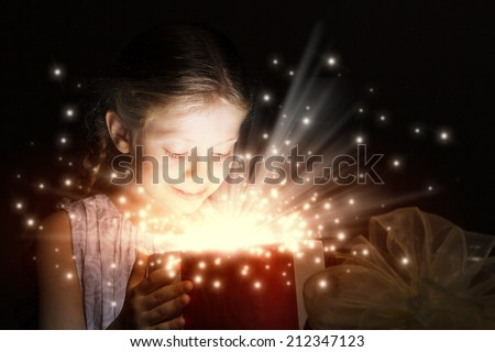 Happy surprised girl opening Christmas present box - stock photo