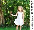 Happy sweet little girl portrait in a park - stock photo