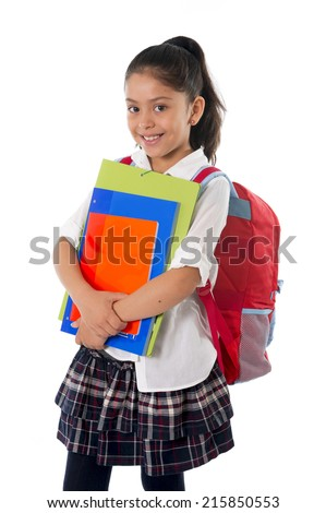happy sweet little school girl carrying schoolbag backpack and books smiling in education and back to school concept isolated on white background - stock photo