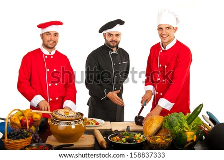 Happy teacher chef with students in kitchen isolated on white - stock photo