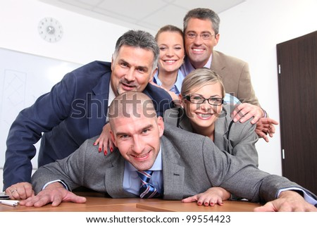 Happy team of business people - stock photo